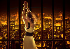Relaxed woman on the top of the building Royalty Free Stock Images