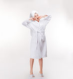 Relaxed woman with towel on her head stretching and yawning royalty free stock photos
