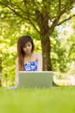Relaxed woman using laptop in park Royalty Free Stock Images