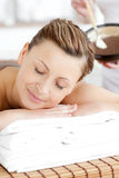 Relaxed woman waiting for a mud treatment Stock Image