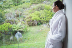 Relaxed woman wearing a bathrobe Stock Images