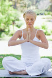 Relaxed woman in a yoga position Stock Photo