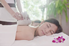 Relaxed Women Receiving Herbal Massage royalty free stock photo