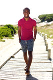 Relaxed young african man walking outdoors Stock Photos