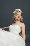 Relaxed young bride reclining in a chair Royalty Free Stock Photography