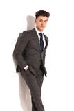Relaxed young business man in grey suit Royalty Free Stock Images