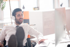 Relaxed young business man at office Stock Images