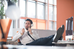 Relaxed young business man at office Royalty Free Stock Photos