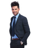 Relaxed young business man smiling at the camera Stock Photo