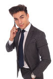 Relaxed young business man talking on the phone Stock Photo