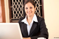 Relaxed young business woman Royalty Free Stock Image