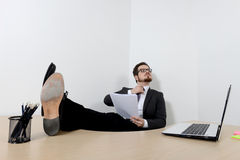 Relaxed young businessman in the office Royalty Free Stock Photography