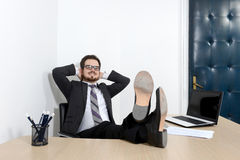 Relaxed young businessman in the office Royalty Free Stock Photo
