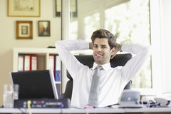 Relaxed Young Businessman Stock Photo