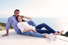 Relaxed young couple at home Stock Photos