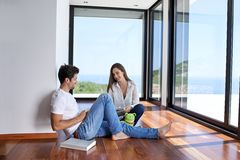 Relaxed young couple at home staircase Stock Photos
