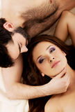 Relaxed young couple lying in bed. Royalty Free Stock Photo