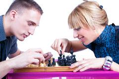 Relaxed young couple playing chess at home Royalty Free Stock Photography