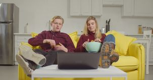 Relaxed couple watching online tv on laptop stock footage