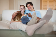 Relaxed young couple watching television Stock Image