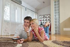 Relaxed young  couple watching tv at home Stock Photography