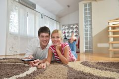 Relaxed young  couple watching tv at home Stock Photo