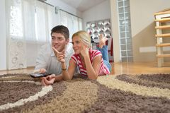 Relaxed young  couple watching tv at home Royalty Free Stock Photography