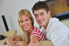 Relaxed young  couple watching tv at home Royalty Free Stock Images