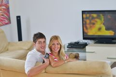 Relaxed young  couple watching tv at home Stock Images
