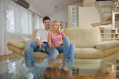 Relaxed young  couple watching tv at home Royalty Free Stock Image