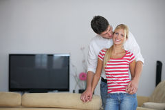 Relaxed young  couple watching tv at home Royalty Free Stock Photo