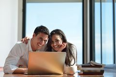 Relaxed young couple working on laptop computer at home Royalty Free Stock Photo