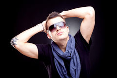 Relaxed young fashion guy Royalty Free Stock Photos