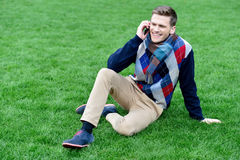 Relaxed young fashion guy on call Stock Images