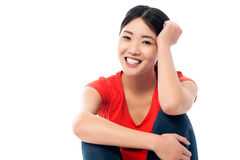 Relaxed young girl smiling while thinking something Stock Images