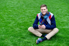 Relaxed young guy enjoying his day out Royalty Free Stock Photo