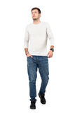Relaxed young man in casual wear walking towards camera looking up Stock Photos