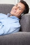 Relaxed Young Man on Couch Royalty Free Stock Image