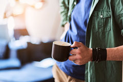 Relaxed young man drinking hot beverage Royalty Free Stock Photos