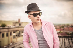 Relaxed young man with hat and sunglasses royalty free stock photos
