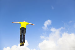 Relaxed young man jumping Stock Photo