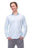Relaxed young man smiling on isolated white background Royalty Free Stock Photos