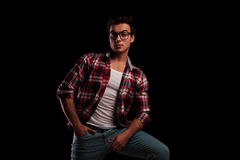 Relaxed young man wearing glasses and standing Royalty Free Stock Images
