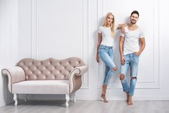Relaxed Young People Leaning On The Decorative Wall Royalty Free Stock Image