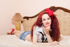 Relaxed young redhead woman lying on her belly Royalty Free Stock Photos