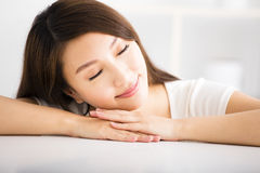 Relaxed young smiling woman  in living room Stock Images
