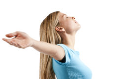 Relaxed young woman with arms outstretched Royalty Free Stock Photos