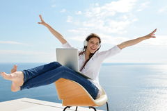 Relaxed Young Woman At Home Working On Laptop Stock Photos