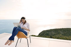 Relaxed Young Woman At Home Working On Laptop Stock Photography