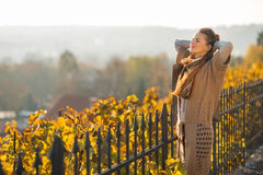 Relaxed young woman in autumn outdoors Stock Photo